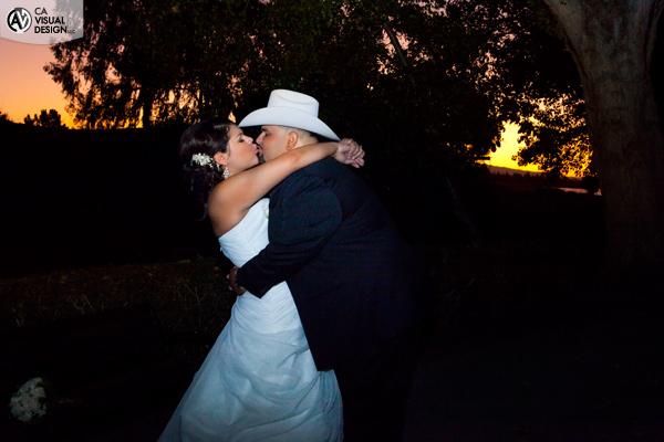 Romantic wedding portrait against the beautiful sunset.